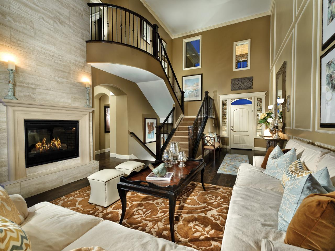 Transitional Living Room With Stairs And Marble Fireplace