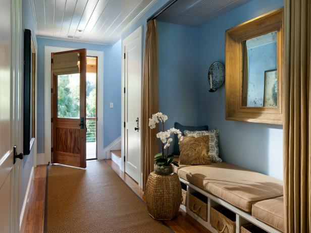 Blue Entry Hall Features Sisal Rug and Built-In Bench