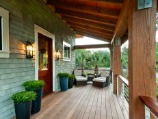 In keeping with classic Low Country cottages, this home boasts an elevated front porch, clad in durable garapa wood decking.