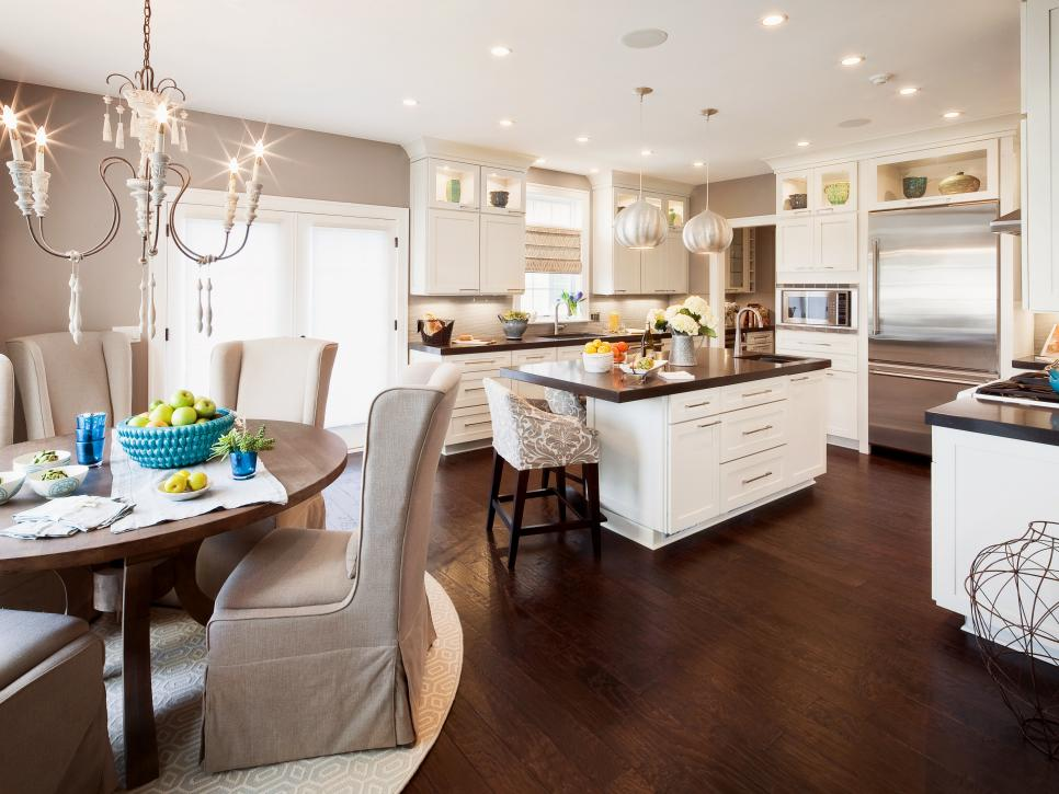 Transitional White Kitchen With Dark Hardwood Floors and Chandelier