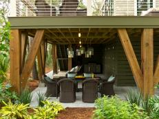 The ground-level gathering area accommodates both outdoor dining and relaxation.
