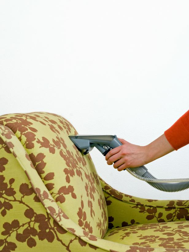Vacuuming Green and Brown Chair