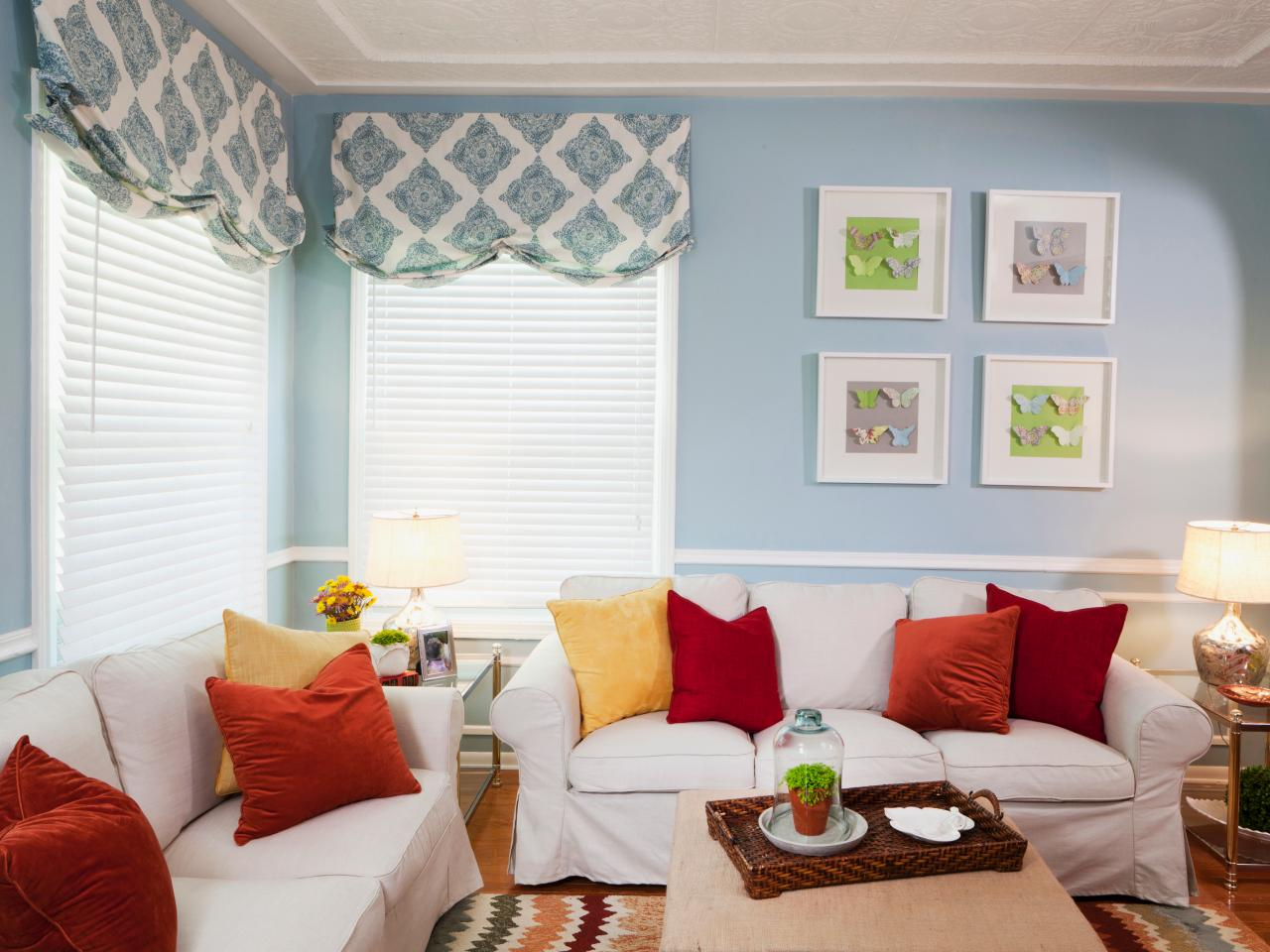 blue and white living room with orange and red accents hgtv. Black Bedroom Furniture Sets. Home Design Ideas