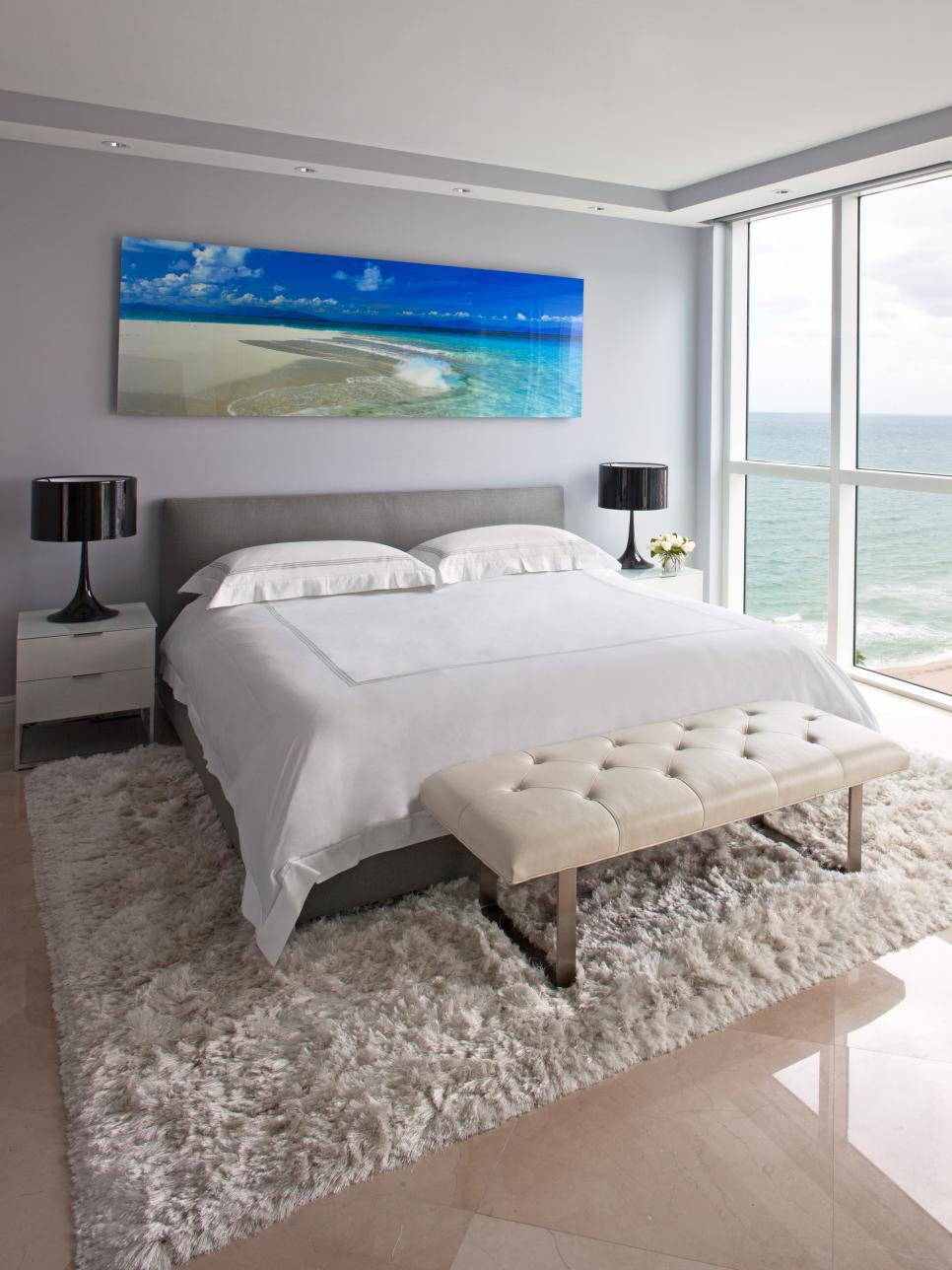 Contemporary Light Gray Bedroom With Ocean Artwork and Ocean View