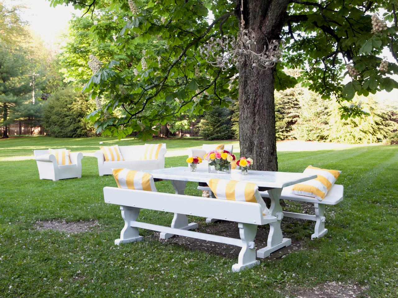 White Picnic Table With Yellow Striped Pillows