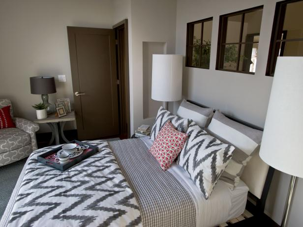Gray and White Guest Bedroom With Slanted Headboard