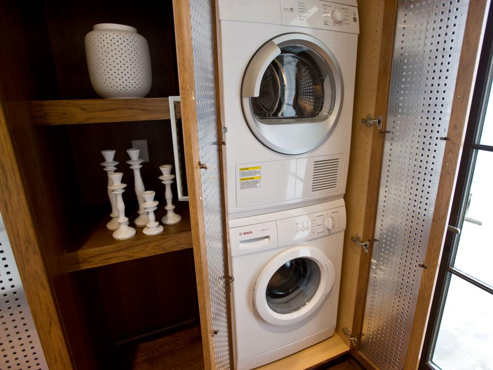 Hickory Cabinet With White Front-Loading Washer and Dryer