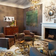 Gold and Gray Living Room With Unique Light Fixture