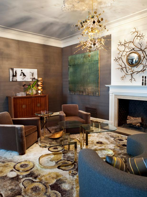 Gold and Gray Living Room With Unique Light Fixture and Wall Art