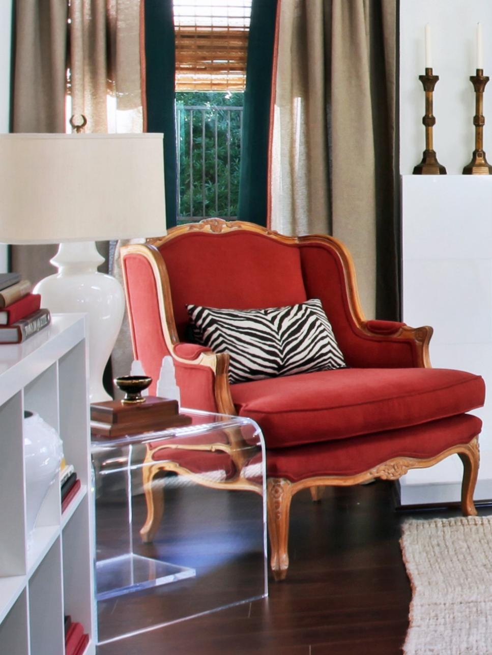 Red Chair With Wood Trim Paired With Lucite End Table