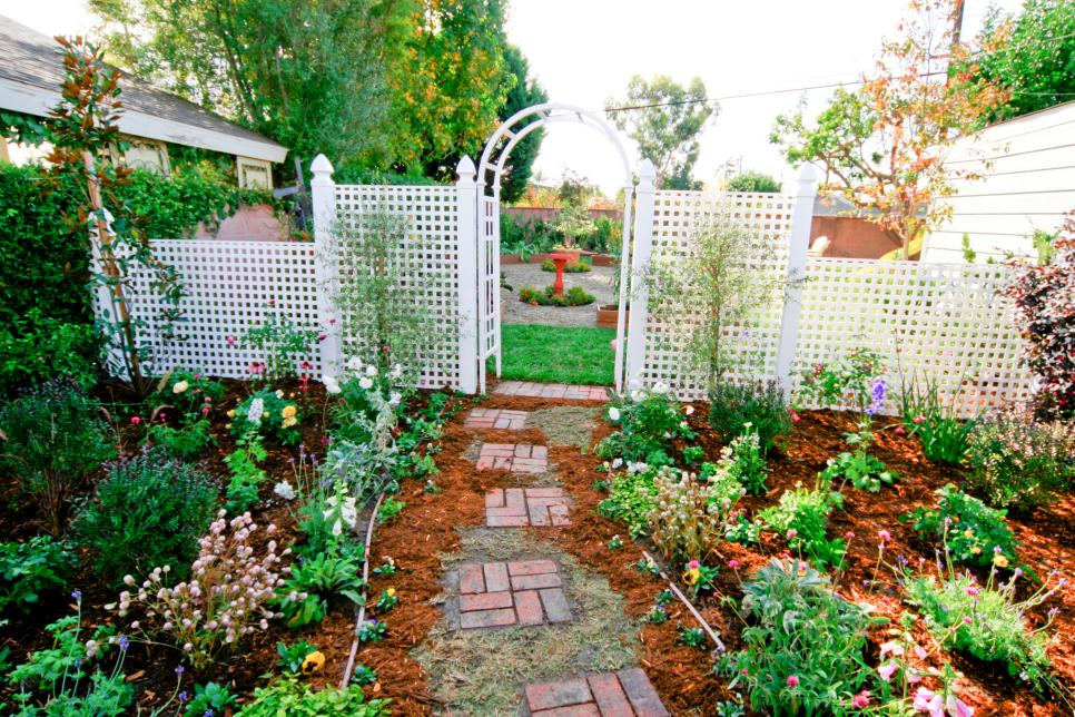 Garden With White Arbor and Red Bird Bath