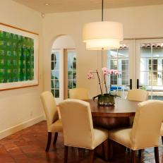 Neutral Dining Room With Green Artwork