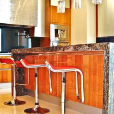 Modern Kitchen With Red Bar Stools