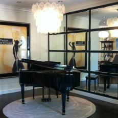 Black Grand Piano With Tile Mirrored Wall and Chandelier