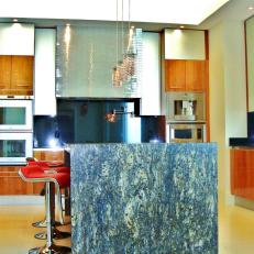 Neutral Modern Kitchen With Dark Granite Island and Double Ovens