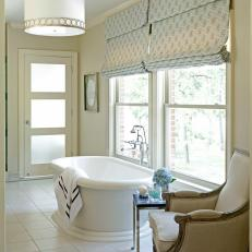 Relaxing White Bathroom With a Freestanding Bathtub