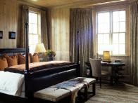 CI-Blackberry-Farm_bedroom-warm-colors-wood-paneling_s4x3