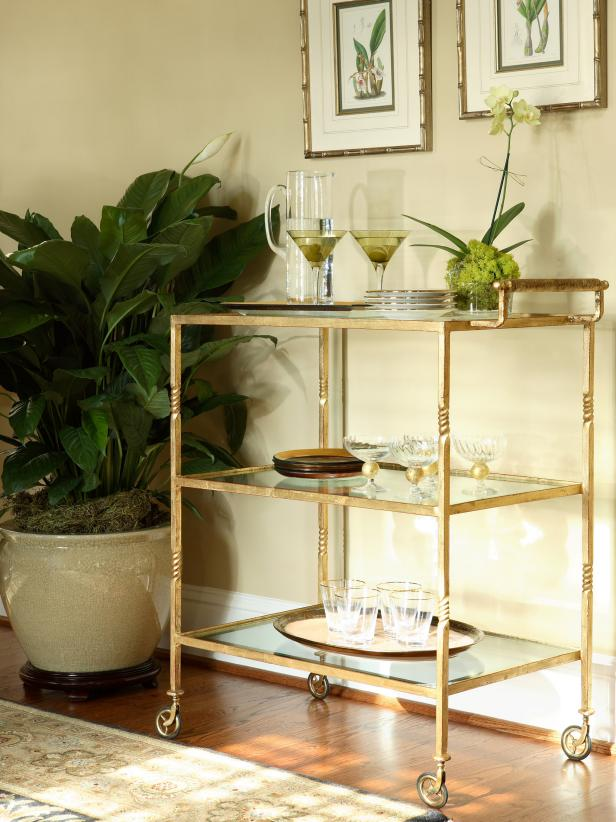 Gold Mobile Bar Cart on Wheels With Glass Shelves and Dish Ware