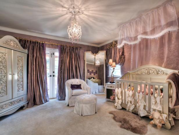 Lavender Nursery With Ornate White Furniture and Crystal Chandelier