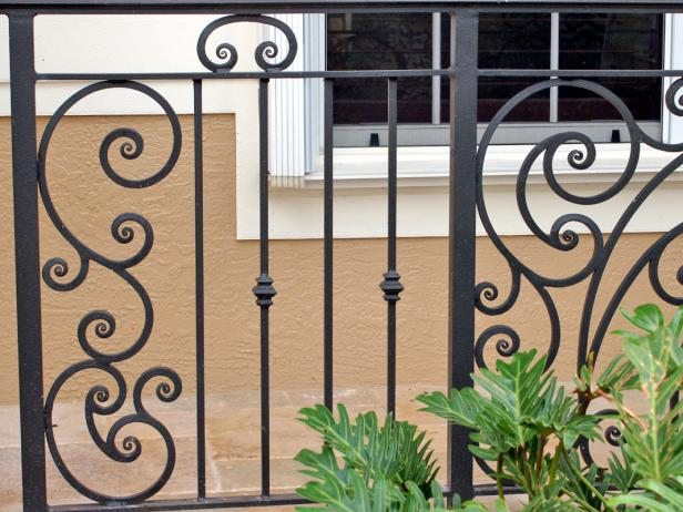 Metal porch railing is more durable than wood, and can be found in a range of designs to complement your home's architectural style.
