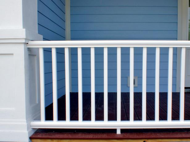 Synthetic porch railings include PVC and composite materials that blend wood particles with resin and vinyl. The surface can be colored and textured to resemble natural wood.