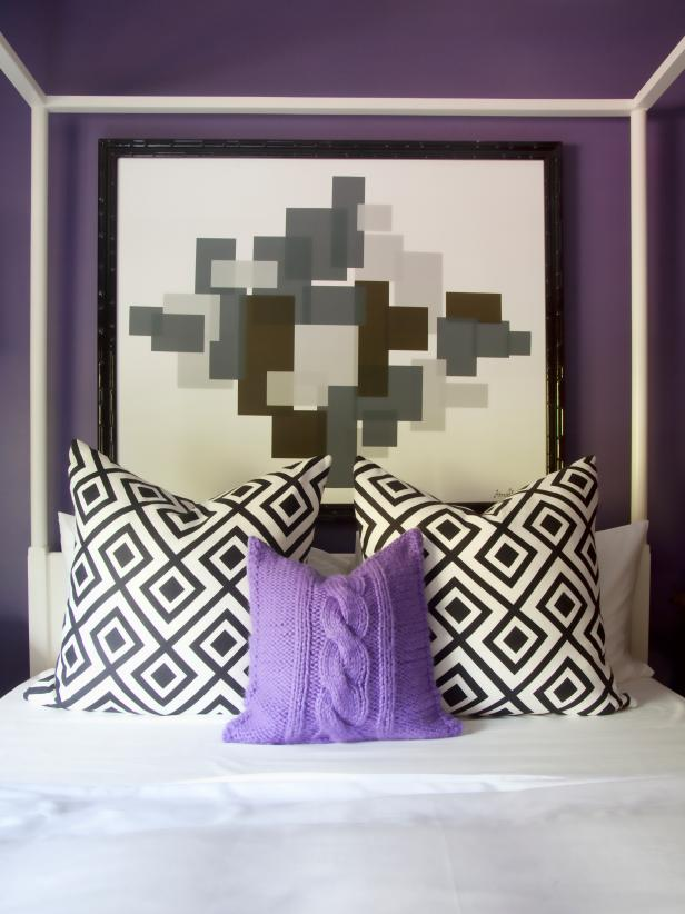 Purple Bedroom With Black & White Graphic Pillows and Artwork