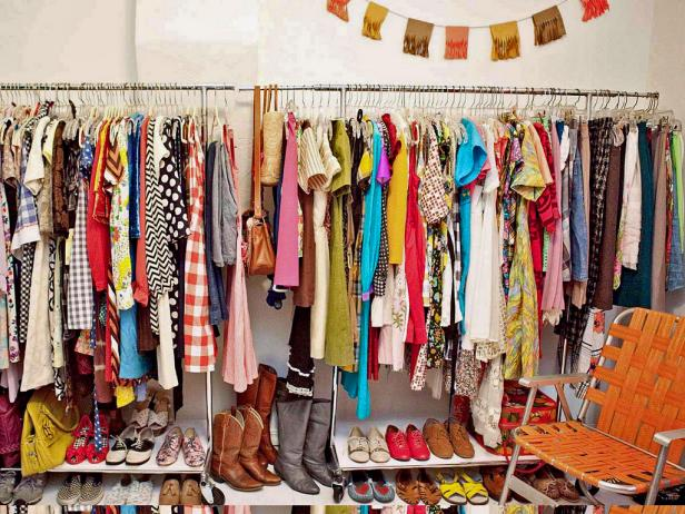 Cluttered, Full Closet With Hanging Clothes and Shoe Shelves