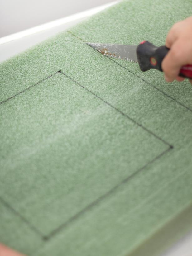 Use a drywall or foam-cutting knife to cut the foam along the lines drawn in the previous step.