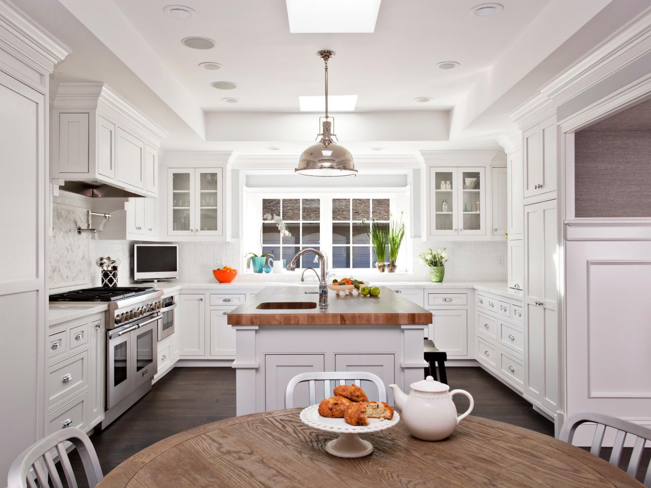Transitional White Kitchen With Butcher Block Island | HGTV