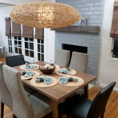 Transitional Dining Room With Gray Brick Fireplace