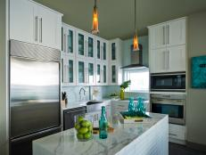 Contemporary White Kitchen with Marble Island