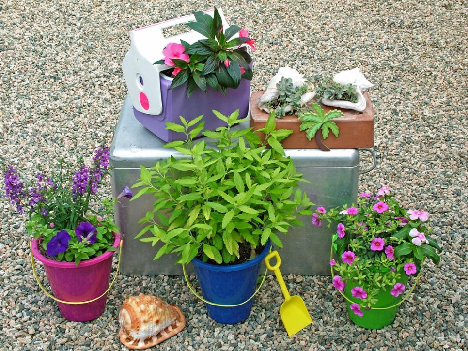 Stunning Low-Budget Container Gardens | HGTV on backyard urn ideas, backyard patio ideas, cheap retaining wall ideas, backyard rose ideas, diy flower garden design ideas, backyard fence ideas, backyard gift ideas, tropical landscape patio design ideas, backyard outdoor ideas, backyard wood ideas, backyard landscaping ideas, back yard landscaping design ideas, backyard shelf ideas, small backyard ideas, outdoor flower pot decorating ideas, backyard plant ideas, backyard statue ideas, backyard bed ideas, backyard light ideas, backyard flowers ideas,