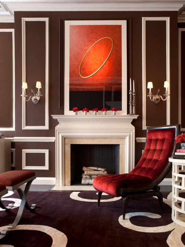 White Fireplace With Red Upholstered Chair