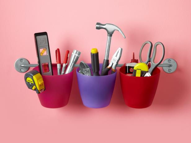 Colorful Hanging Plastic Buckets Containing Tools