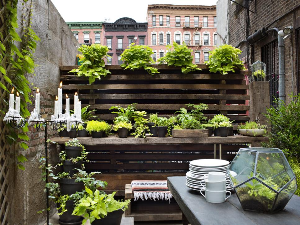Small garden ideas designs for small spaces hgtv for Cool apartment patio ideas