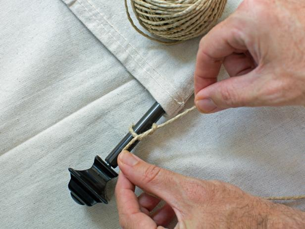 Add a hanger by tying twine on to rod and knotting it onto each end of the rod.