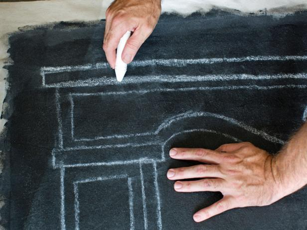 Use chalk to draw the silhouette of a mantel for faux mantel hanging.