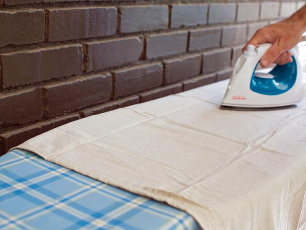 Use iron to remove all wrinkles from drop cloth you will be using for the faux holiday mantel hanging.