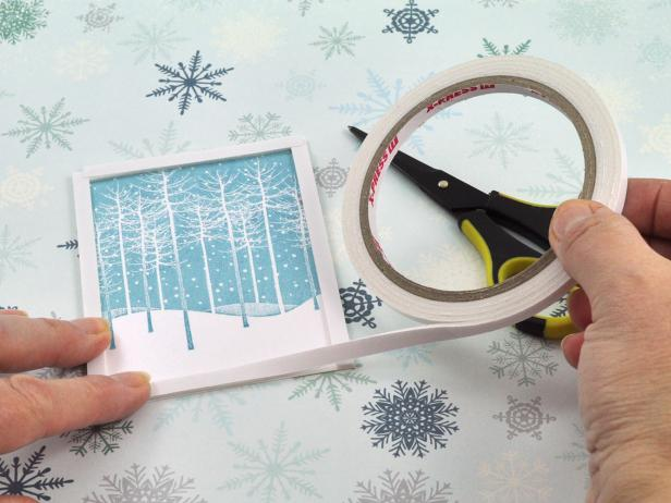 Line stamped focal image you are using for the handmade holiday snow shaker card with foam tape, leaving no gaps in the corners.