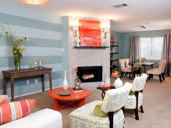 Eclectic Blue and Orange Living Room With Fireplace and Paisley Patterned Chairs