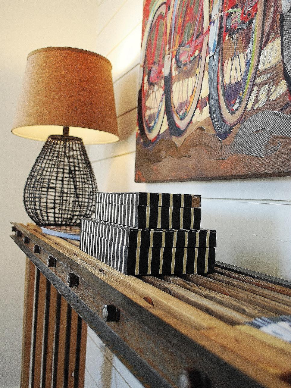 Rustic Wooden Console Table With Iron Lamp and Bicycle Art