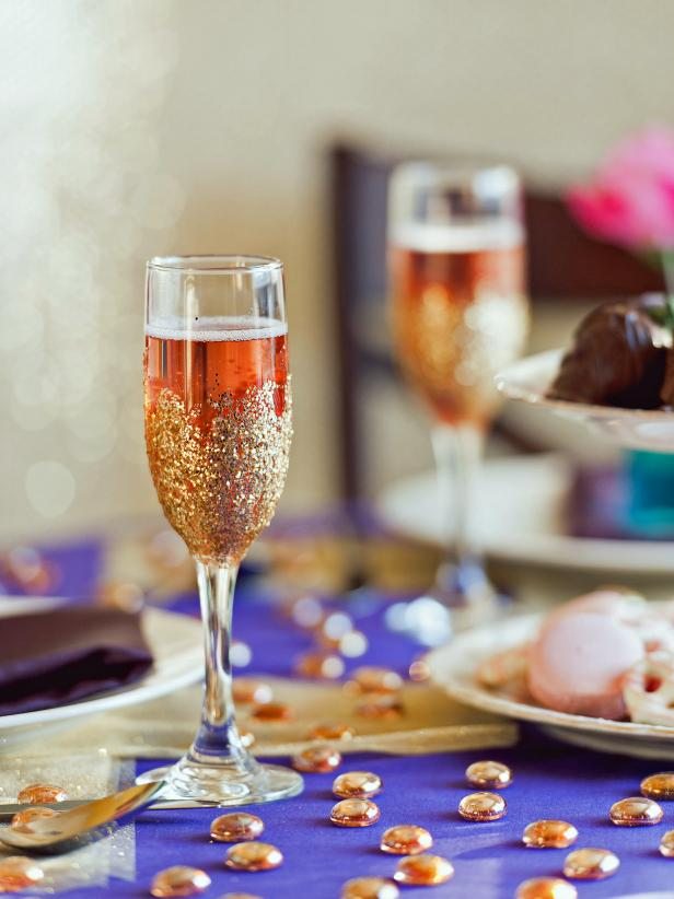 Make easy glitter champagne flutes to add sparkle to a romantic tablescape.