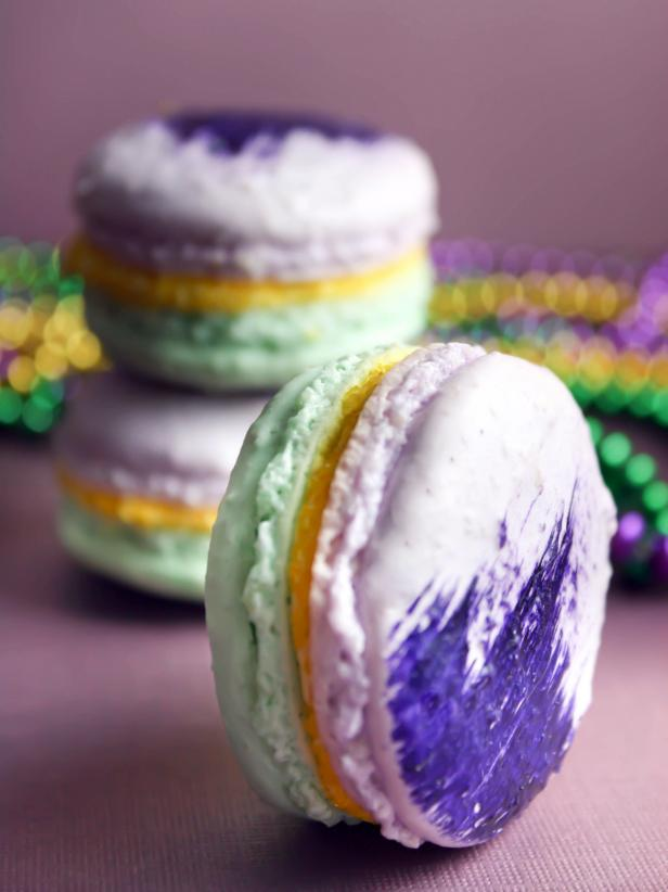 Purple and green macarons with gold filling.