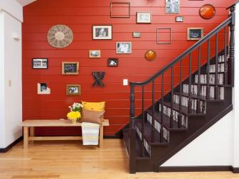 Red Paneled Stairwell and Photo Gallery Wall