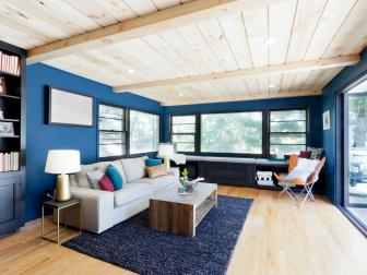 Navy Blue Living Room With Pine Ceilings and Deck Access