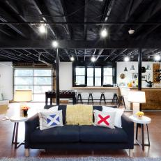 exposed ceiling lighting basement industrial black unfinished basement spacious basement with industrial ceiling photos hgtv