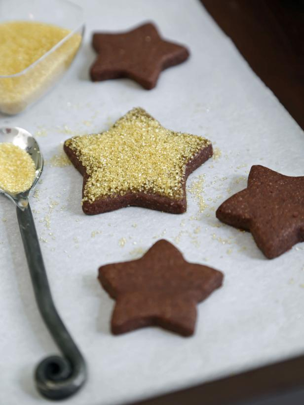 Star shaped chocolate cookies with gold dusting