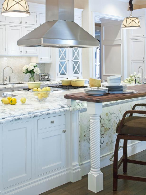 Transitional White Kitchen With Marble Countertops and Stainless Hood