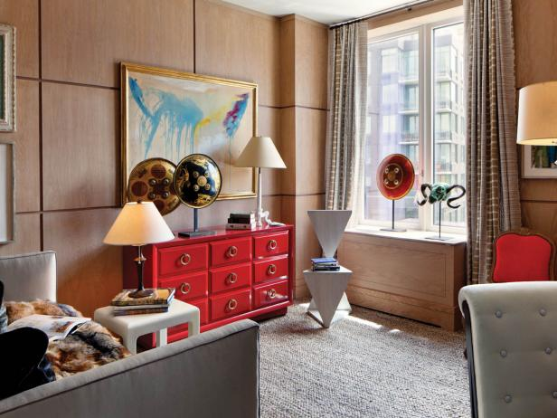 Eclectic Home Office With Wood Paneling and Red Dresser