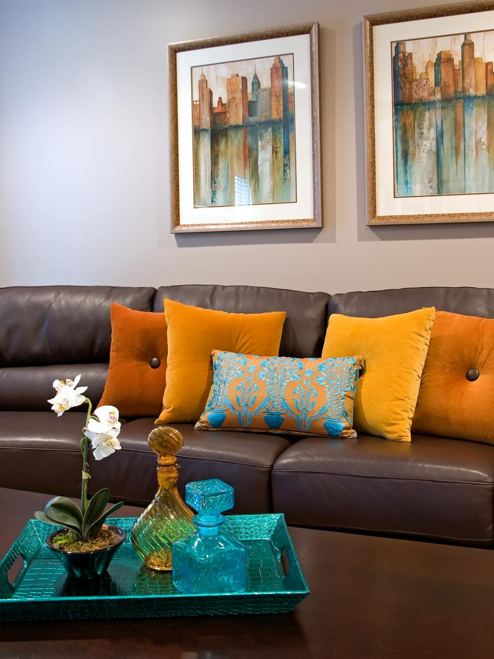 Contemporary Brown Leather Sofa With Orange Throw Pillows Hgtv